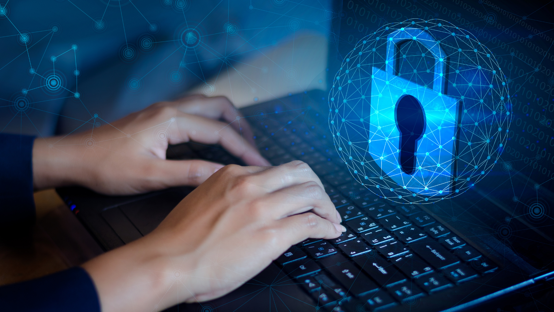 Telecom professional implementing cyber security on laptop