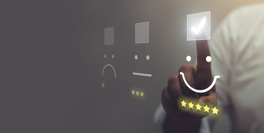 Telecom customer pressing smiley face emoticon on virtual touch screen to indicate customer satisfaction and evaluate service