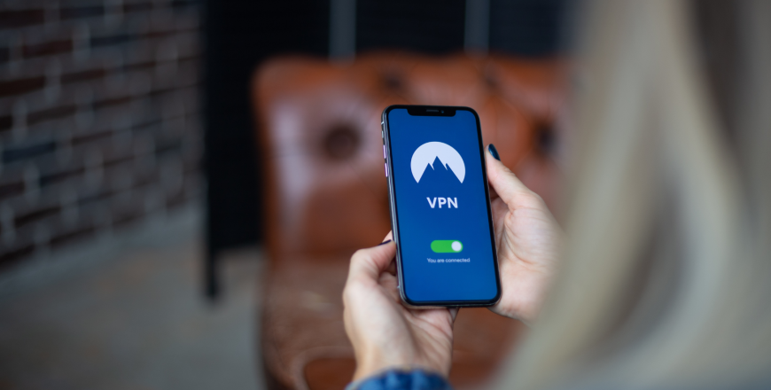 Telecom professional configuring Virtual Private Network (VPN) to mask IP address on mobile phone