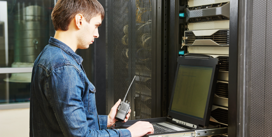 Network engineer configuring network in server room
