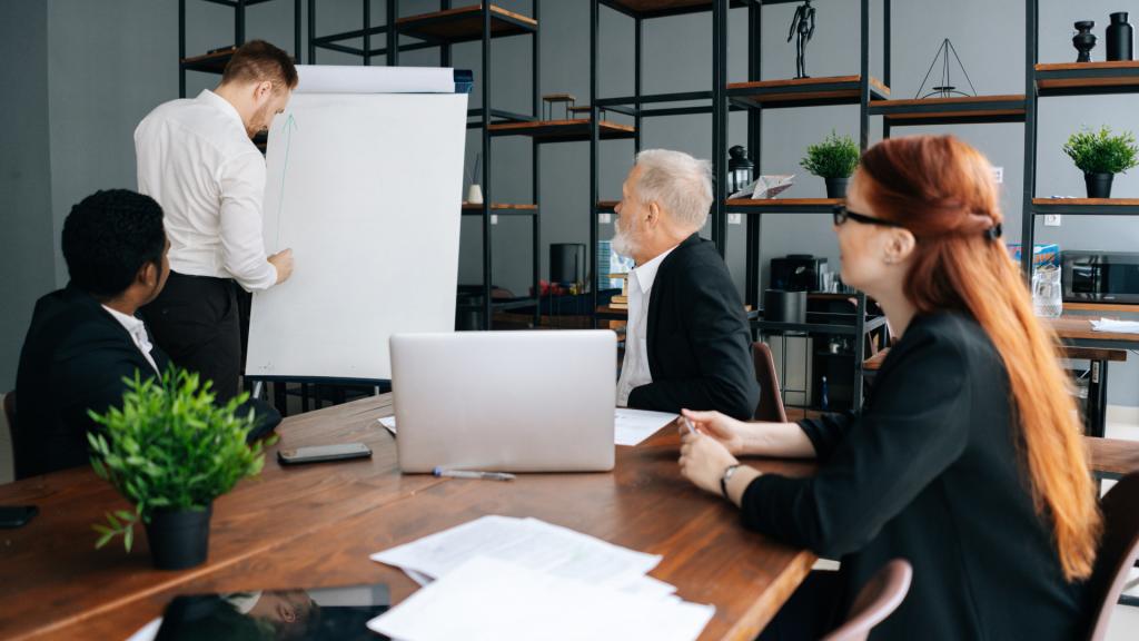 Telefocal executive coach giving presentation in an office