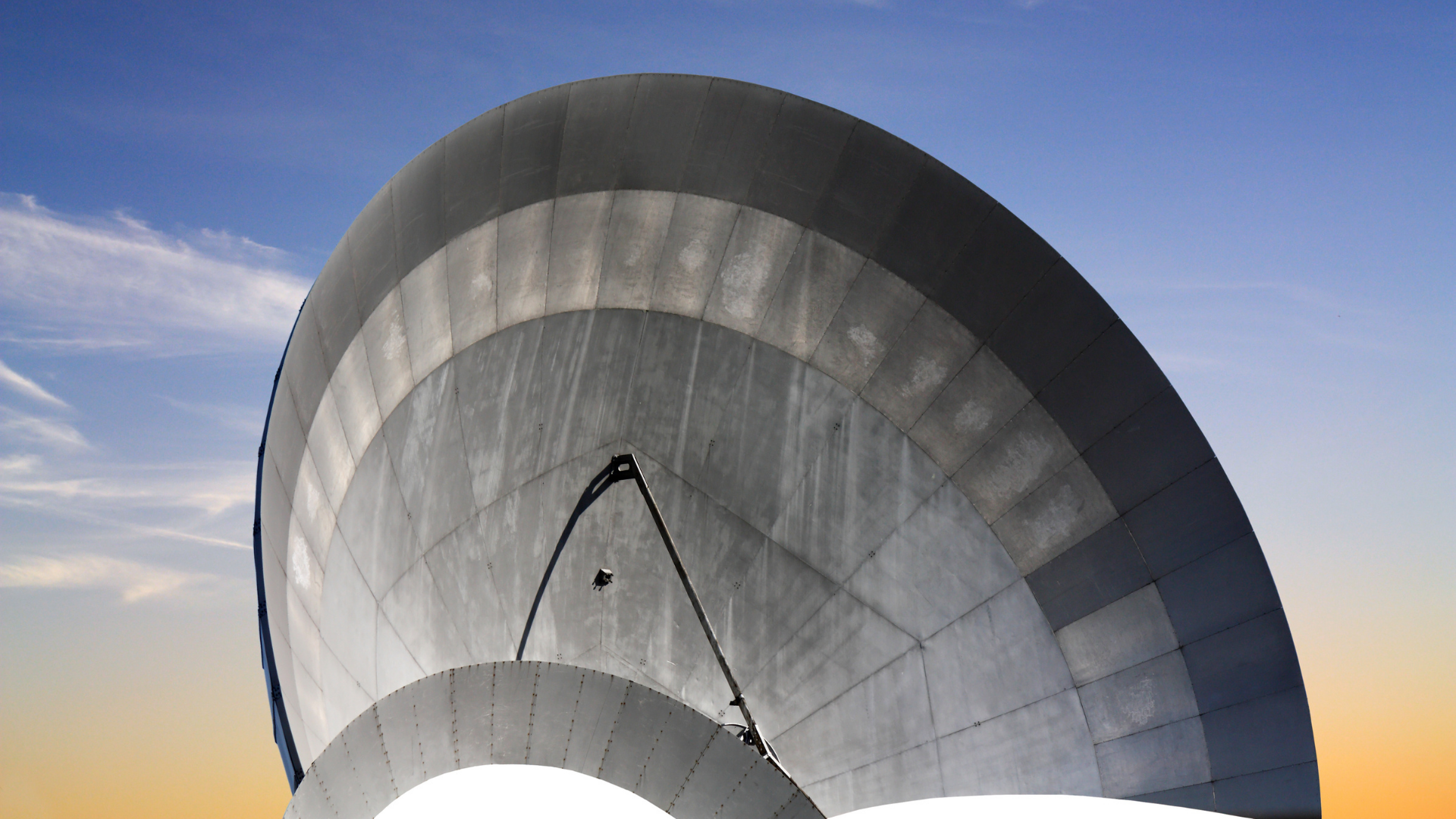 Satellite dish with a metallic reflex reflector in operation for satellite communications