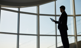 Businessman with touchpad networking inside business building
