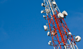 Radio transmission tower against sky background