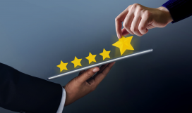 Client giving 5 stars rating on digital tablet