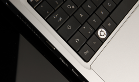 Computer with Ubuntu software logo on keyboard
