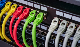 Multi-coloured ethernet cables connected to router
