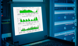 Monitor showing graph information of network traffic and wireless status of device in server room data centre