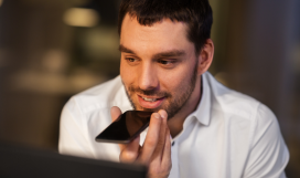 Telecom professional using voice call on mobile device